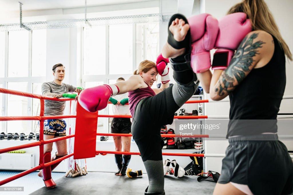 Women Sparring At Thai Boxing Gym : Stock Photo