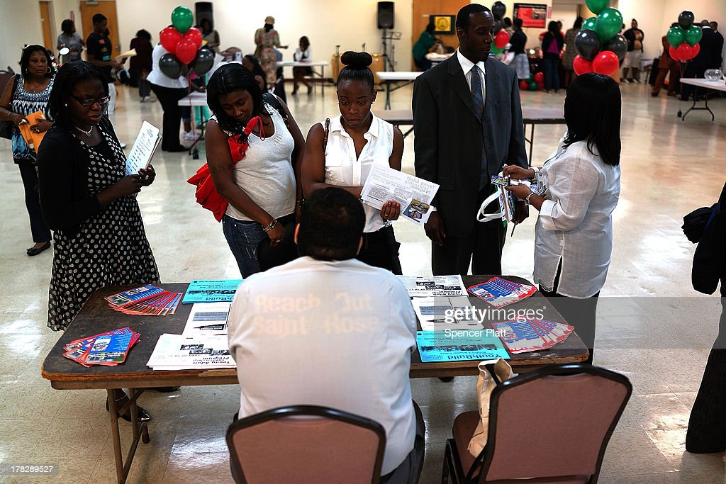 Women speak with an employment recruiter at the 'Beyond the Dream' job fair at the Brown Memorial Baptist Church in Clinton Hill, Brooklyn on August 28, 2013 in New York City. A new report by the Fiscal Policy Institute on New York's economy calls the last 10 years a 'lost decade' for typical workers. The report by the nonpartisan think tank found that median wages dropped almost 7 percent for men and about 1 percent for women.