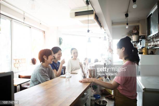 women spending their time in the afternoon cafe - catering building stock pictures, royalty-free photos & images