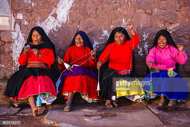 women spinning wool on taquile island, lake titicaca, peru - indigenous peoples of south america stock pictures, royalty-free photos & images