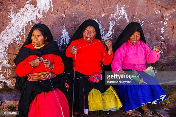 Women spinning wool on Taquile Island, Lake Titicaca, Peru