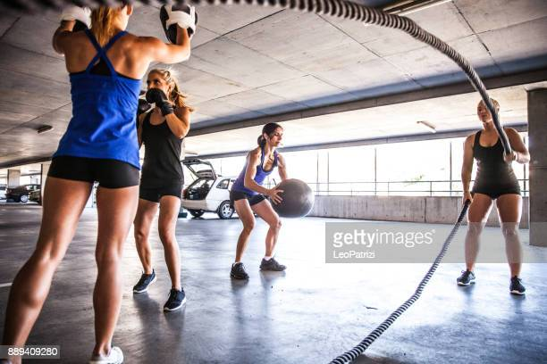 women sport team boxing outdoor - small group of people stock pictures, royalty-free photos & images