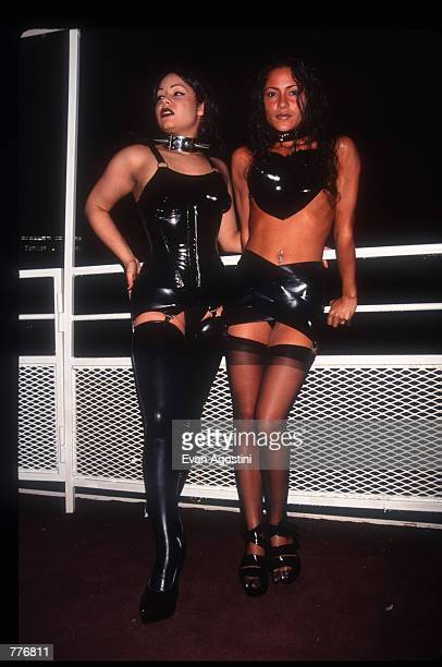 Women stand in fetish gear at the third Black Blue Ball fetish event May 3 1996 in New York City Hosted by subculture personality Mistress Carrie the...