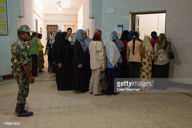 CONTENT] Women stand in line to cast their vote at a polling station in Cairo for the second round of the Egyptian presidential elections