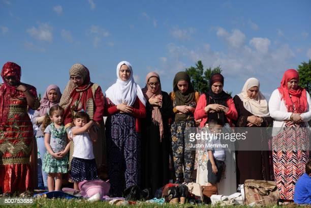 Women stand in prayer during an Eid alFitr celebration marking the end of Ramadan on June 25 2017 in Pittsburgh Pennsylvania The celebration marks...