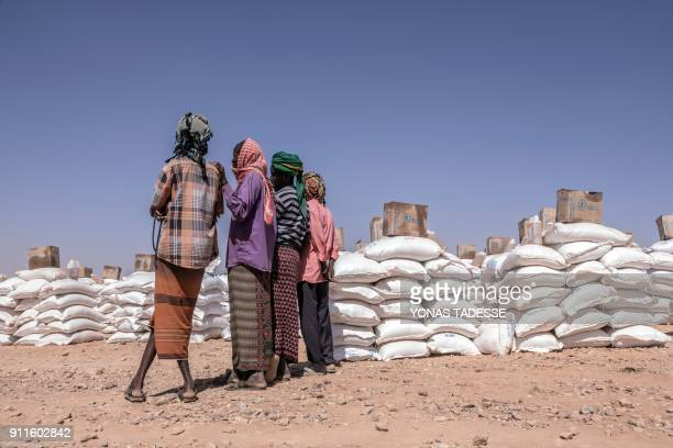 Women stand near supplies brought by the World Food Programm at the Internally displaced person camp of Farburo in Gode near Kebri Dahar southeastern...
