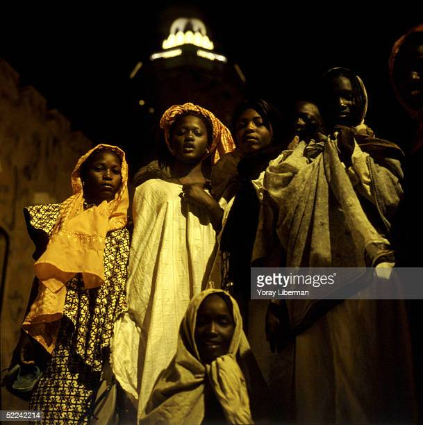 Women stand near the mosque of Touba on April 23 2003 in Touba Senegal The Mouride Baye Fall community in Senegal celebrates the Magal De Touba in...