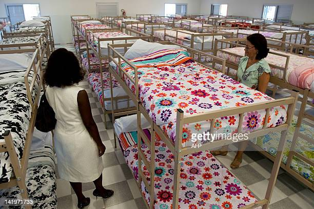 Women stand next to beds at Prates Complex a center that will host homeless people alcoholics and drug addicts on March 27 2012 in Sao Paulo Brazil...