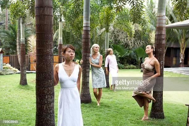 Women standing by tree