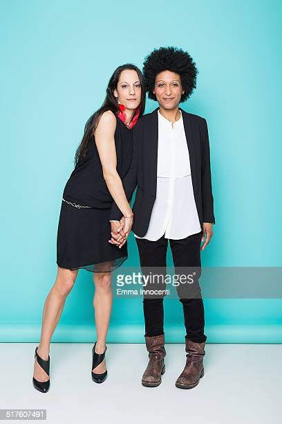 women standing holding hands - lgbtq  female fotografías e imágenes de stock
