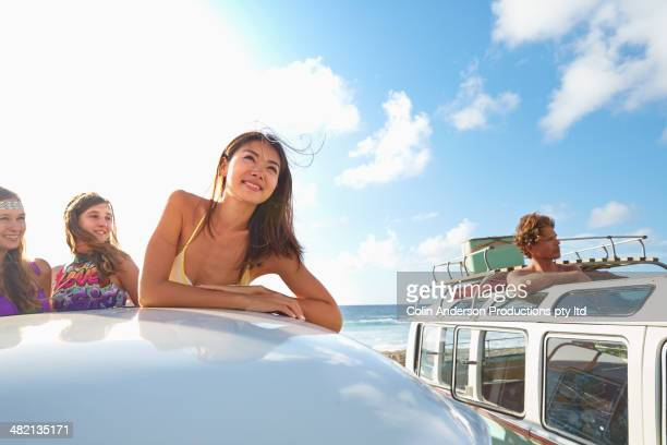 women standing in van on beach - japanese girls hot stock photos and pictures
