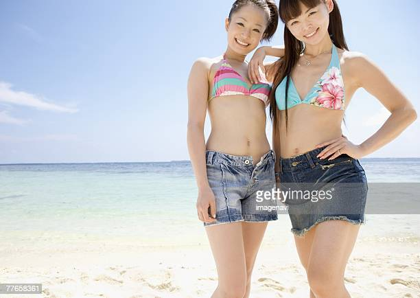 women standing on beach - japanese short skirts stock photos and pictures