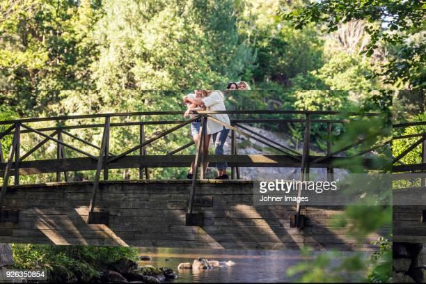 Women standing on bridge