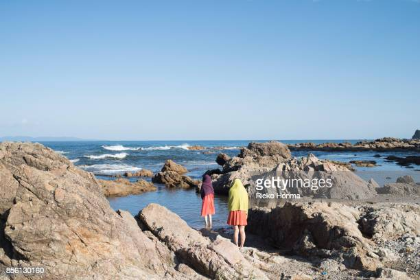 Women standing on the rock