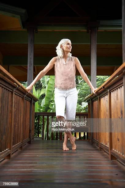Women standing on wooden bridge