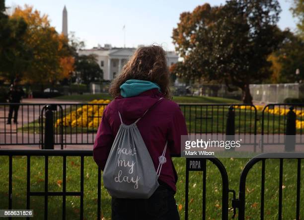 A women stands at a security fence in front of Lafayette square that was closed as US Vice President Mike Pence's motorcade passed by on October 31...