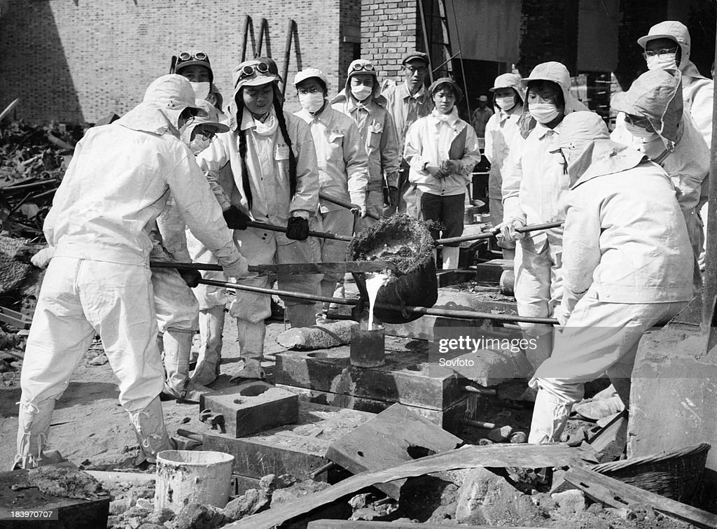 Women steel workers of the Chunghua Metallurgical Plant in Shanghai pouring molten steel that they smelted into sand moulds. Women have joined iron and steel making this year. Great Leap Forward. December 1958.