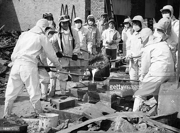 Women steel workers of the Chunghua Metallurgical Plant in Shanghai pouring molten steel that they smelted into sand moulds Women have joined iron...