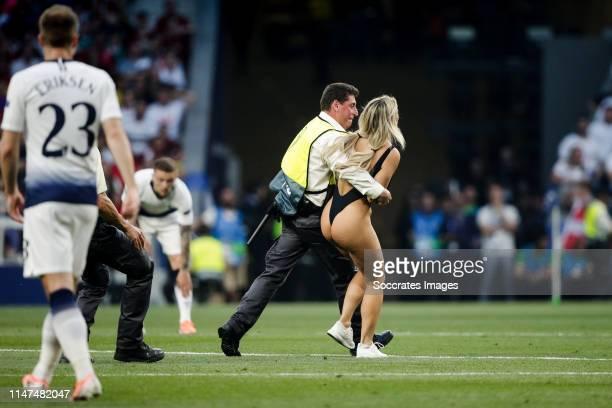 Women streaker during the UEFA Champions League match between Tottenham Hotspur v Liverpool at the Wanda Metropolitano on June 1 2019 in Madrid Spain