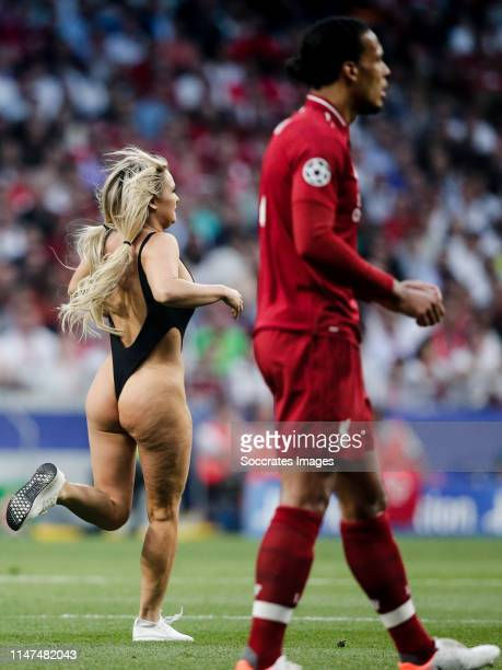 Women streaker Virgil van Dijk of Liverpool FC during the UEFA Champions League match between Tottenham Hotspur v Liverpool at the Wanda...