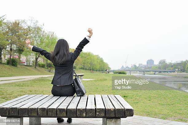Women stretch on the bench