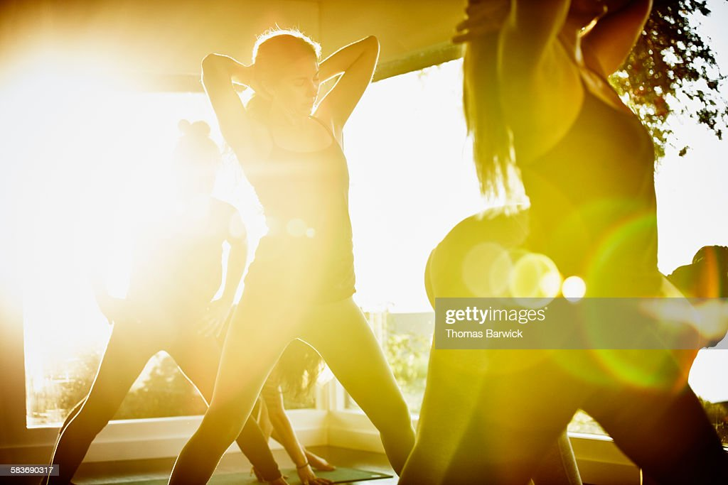 Women stretching and preparing for yoga class : Stock Photo