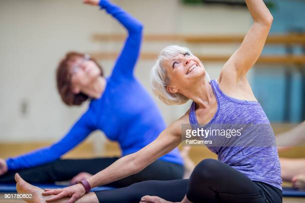 women stretching - 50 59 years stock pictures, royalty-free photos & images