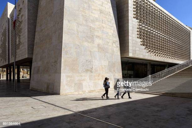 Women stroll past the limestone steps of Valletta's Parliament designed by Italian architect Renzo Piano on December 7 2017 in Valletta Malta...