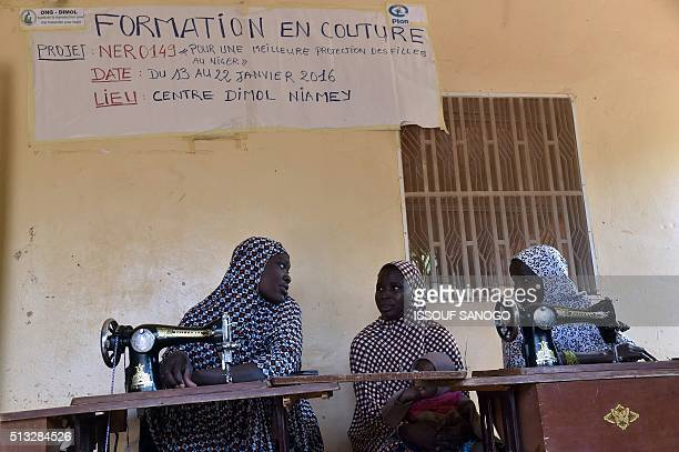 Women suffering from obstetric fistula attend a sewing workshop at the health centre of the DIMOL nongovernmental organisation in Niamey on February...