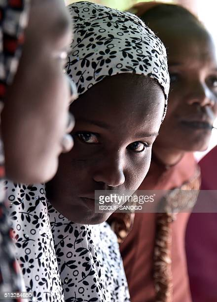 Women suffering from obstetric fistula pose as they go about with their daily life in the health centre of the Non Governmental Organisation DIMOL in...