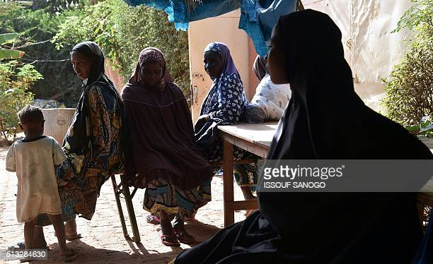 Women suffering from obstetric fistula wait at the health centre of the DIMOL nongovernmental organisation in Niamey on February 19 2016 Niger is in...