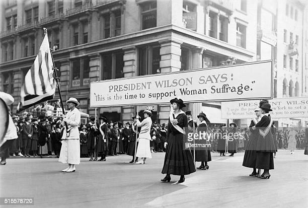Women suffrage parade backing Woodrow Wilson's campaign for Women's votes, 1916. Mrs. Chas, Tiffany with flag. Photograph.