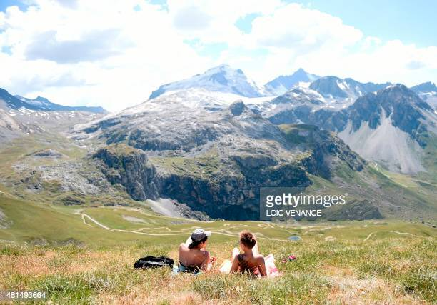 Women sunbathe in Tignes southeastern France on July 21 2015 AFP PHOTO / LOIC VENANCE