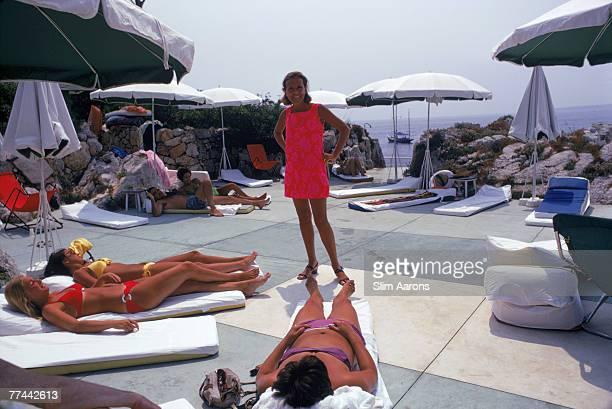 Women sunbathing at the Beach Club in Eden Roc, Antibes, France, August 1969.
