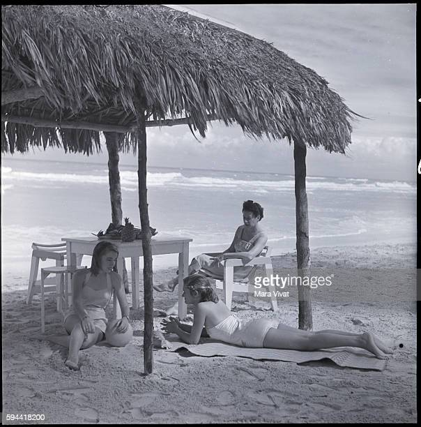 Women Sunbathing Beneath Palapa Cuba