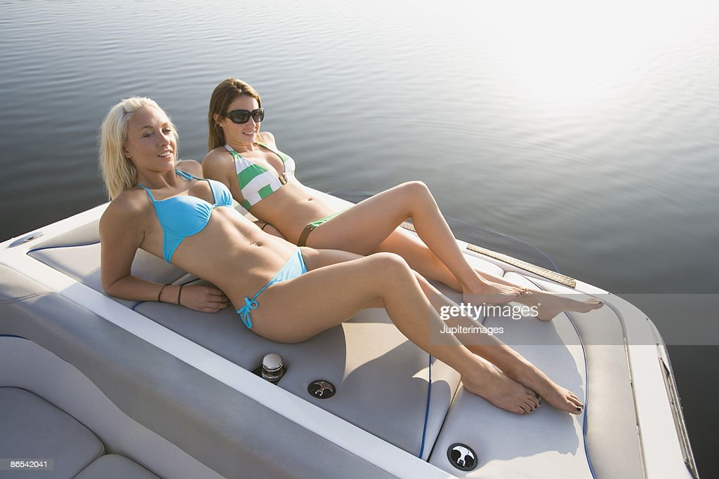 Women Sunbathing On Boat High-Res Stock Photo - Getty Images