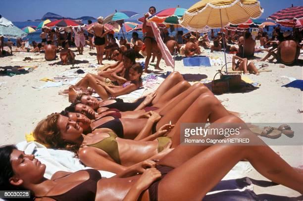 Women sunbathing on Ipanema Beach Rio de Janeiro circa 1990