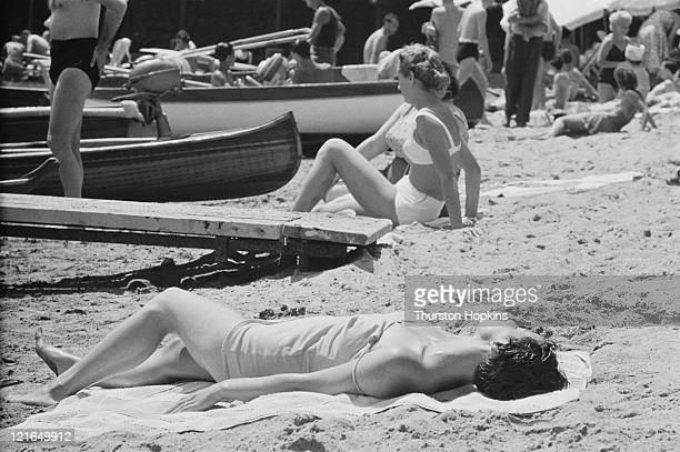Women sunbathing on Paraggi Beach near the tourist resort of Portofino Italy August 1952 Original Publication Picture Post 6023 unpub