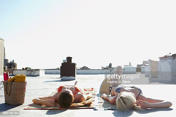 women sunbathing - women sunbathing stock photos and pictures