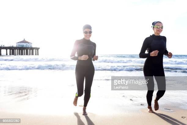 Women swimming into the sea