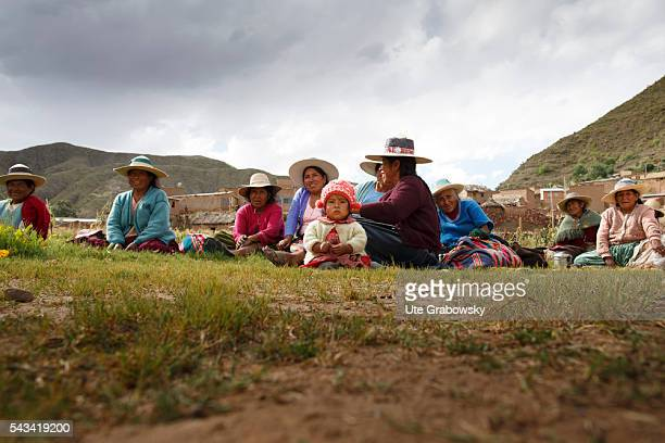 Women take a break from field work in the Andes of Bolivia on April 15 2016 in Tawarchapi Bolivia