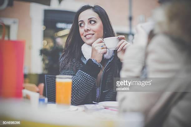 Women take a coffee during shopping