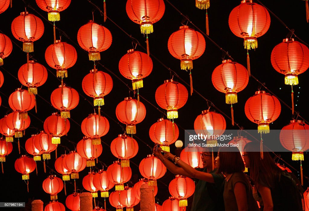 Women take a photograph inside the Thean Hou temple ahead of Lunar New Year of the monkey celebrations outside Kuala Lumpur on February 2, 2016 in Kuala Lumpur, Malaysia. According to the Chinese calendar, the Lunar New Year which falls on February 8 this year marks the Year of the Monkey, the Chinese Lunar New Year also known as the Spring Festival is celebrated from the first day of the first month of the lunar year and ends with Lantern Festival on the Fifteenth day.