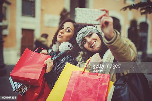 Women take a selfie during shopping in Rome