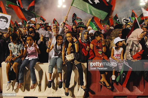 Women take front row positions as thousands of Libyans rally for their revolution in Green Square now renamed Martyrs Square by revolutionary...