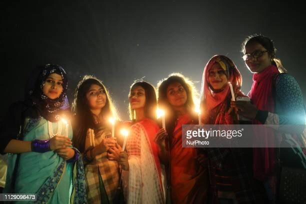 Women take part in a candle light vigil to mark International Women's Day in Dhaka Bangladesh on March 8 2019