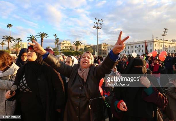 Women take part in a demonstration against eastern military commander Khalifa Haftar, who is based in the east of the country, and in support of the...