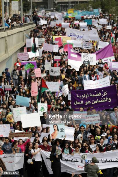 Women take part in a demonstration in the Lebanese capital Beirut on March 11 to mark International Women's Day / AFP PHOTO / ANWAR AMRO