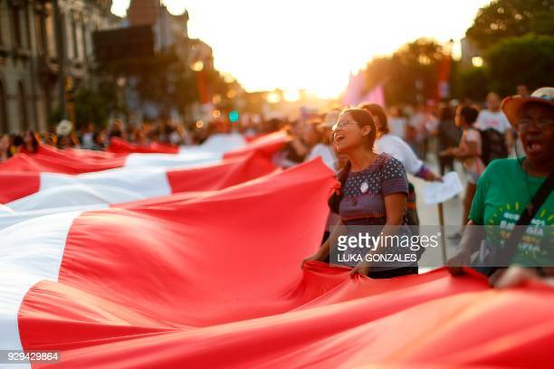 Women take part in a demonstration marking the International Women's Day in Lima on March 8 2018 PHOTO / Luka GONZALES