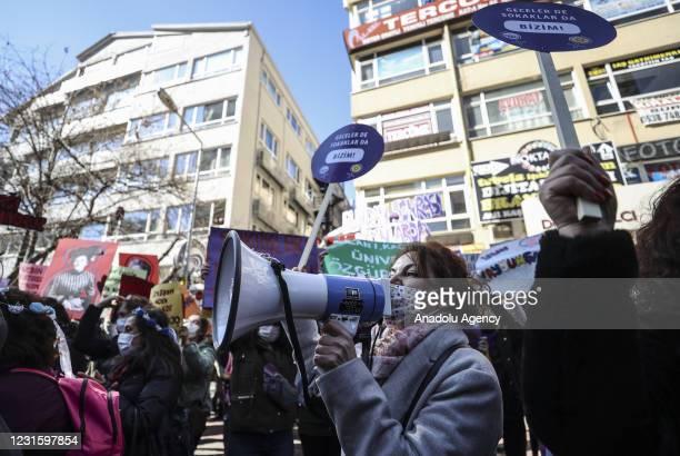 Women take part in a demonstration organized by Ankara Women's Platform to mark the International Women's Day on the Sakarya Street in Ankara, Turkey...